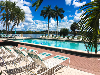Palm Bay 2BR w/ Pools & Hot Tub, Walk to Beach!