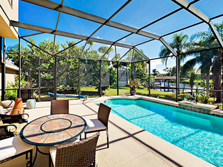 3BR Canal Home w/ Private Screened Pool & Dock